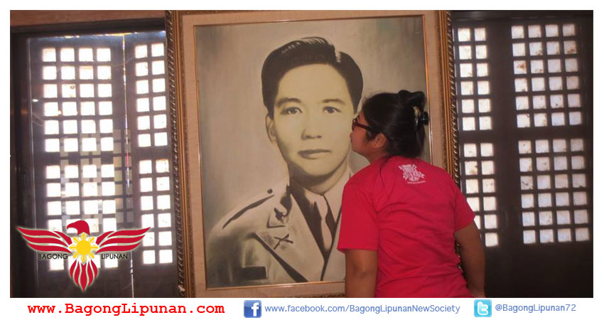 Marcos Museum, Ilocos Norte. Gemma, a Martial Law baby, kisses the photo of former President Ferdinand E. Marcos.