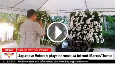 wp-japanes-veteran-plays-harmonica-infront-marcos-tomb